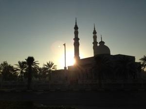 Sunrise behind a mosque